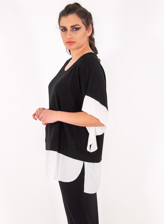 Ασπρόμαυρη μπλούζα με αέρινα μανίκια