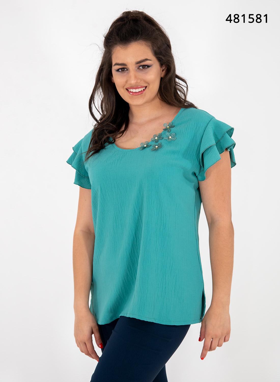 Μονόχρωμη μπλούζα με βολάν