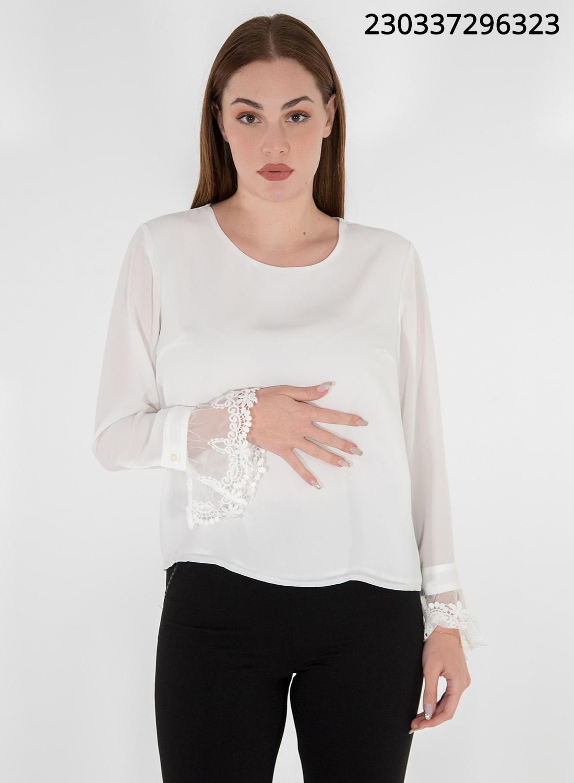 Αέρινη λευκή μπλούζα με δαντέλα στα μανίκια